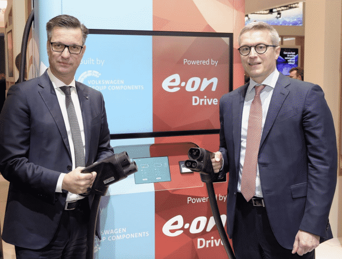 Chairman of the Board of Management of Volkswagen Group Components Thomas Schmall with E.ON Board of Management member Karsten Wildberger